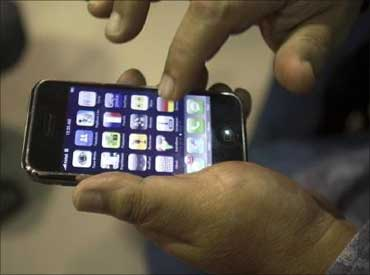 A customer examines his Apple iPhone 3G in Kolkata.