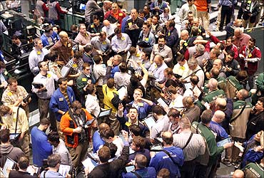 Traders work in the oil options pit on the floor of the New York Mercantile Exchange in New York City.
