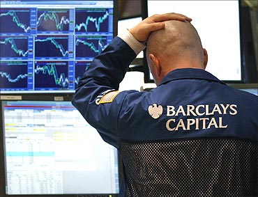 A traders watches his screen on the floor of the New York Stock Exchange.