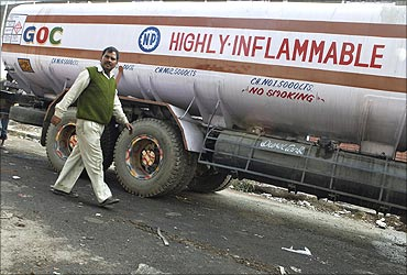 A driver of a diesel tanker walks outside an oil depot in New Delhi.