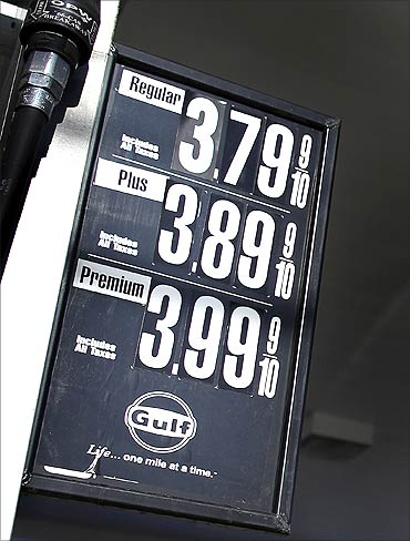 Gas prices are seen posted at a petrol station in New York.