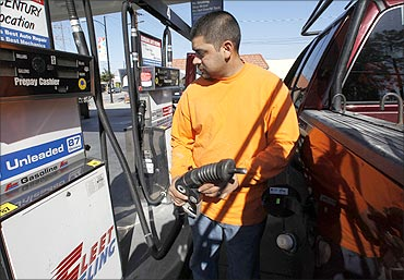 Raul Martinez pumps gas into his employer's truck at Fleet Fueling in Burbank, California.