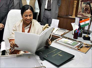Railways Minister Mamata Banerjee smiles before giving the final touches to the Rail Budget.