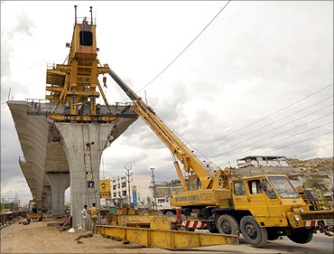Labourers work at a flyover undergoing construction in the southern Indian city of Hyderabad.