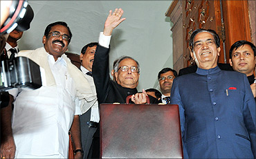 Pranab Mukherjee with Ministers of State of Finance, SS Palanimanickam and Namo Narain Meena.