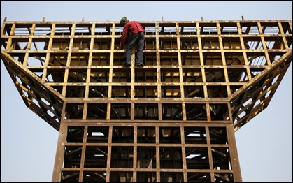 A labourer climbs down from an under-construction pillar of a flyover bridge in Mumbai.
