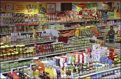 A customer shops inside a grocery store in Lucknow.
