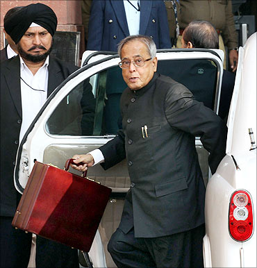 Finance Minister Pranab Mukherjee arrives at his office before presenting the Budget.