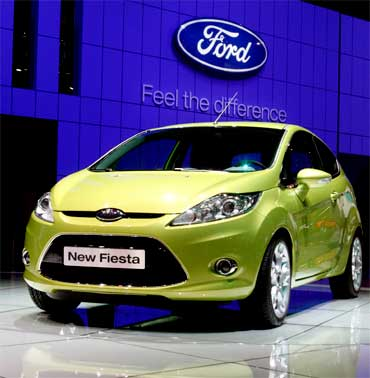 A new Ford Fiesta car is displayed.