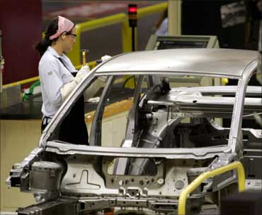 A Ford Motor Company worker works on the assembly line of the Ford Fiesta.