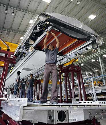Employees assemble a coach inside private railway equipment production unit of Bombardier at Savli.