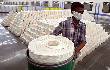 An employee works inside a textile mill in Jhagadia village of Gujarat.