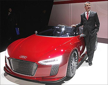 Audi AG Chairman Rupert Stadler poses with the Audi e-tron Spyder concept car at CES, Las Vegas.