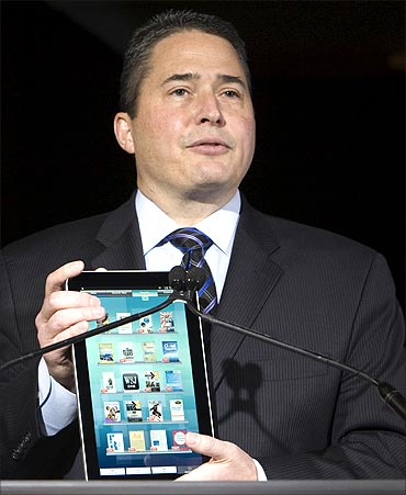 Bob Scaglione, chief marketing officer for Sharp Electronics USA, holds a Galapagos e-Media Tablet.