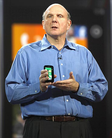 Microsoft CEO Steve Ballmer holds a Windows 7 phone.