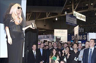 Singer Lady Gaga holds the Polaroid Polarprinter GL10 mobile printer.
