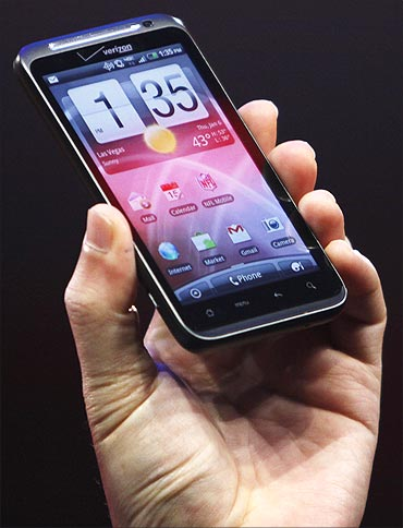 HTC CEO Peter Chou holds a HTC Thunderbolt 4G Verizon smartphone.