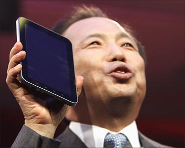 JK Shin, president Samsung's mobile communications business, holds up a new 4G Galaxy Tablet.