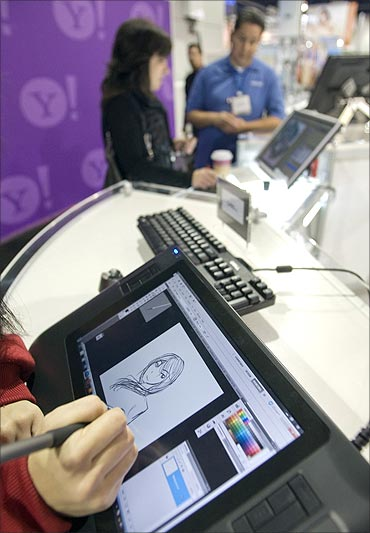 A visitor tries out a Wacom Bamboo Pen and Touch tablet during the 2011 International Consumer Electronics Show (CES) in Las Vegas.