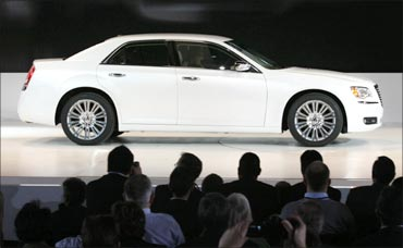 A Chrysler 300 is driven on to the stage at the North American International Auto show in Detroit.