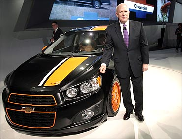 General Motors Chairman and CEO Dan Akerson stands next to the 2011 Chevrolet Sonic Z-spec concept v