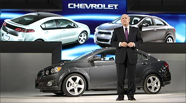 General Motors Chairman and Chief Executive Dan Akerson stands in front of the 2012 Chevrolet.