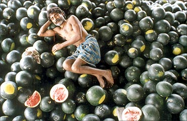 An Indian farmer sleeps on watermelons in Siliguri.