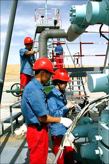 Chinese employees of China National Petroleum Corp work at Tarim Oil Field.