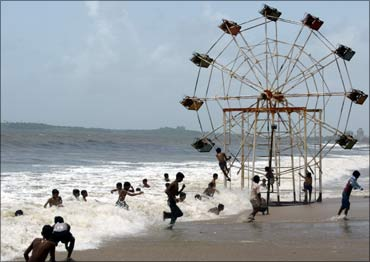 A slightly submerged Ferris wheel at a beach in Mumbai.