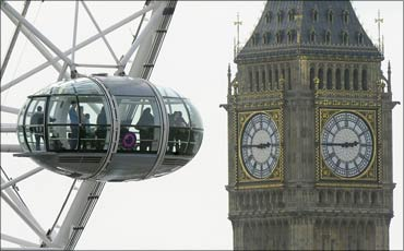 Visitors look out from a pod on the London Eye towards Big Ben and the Parliament in London.