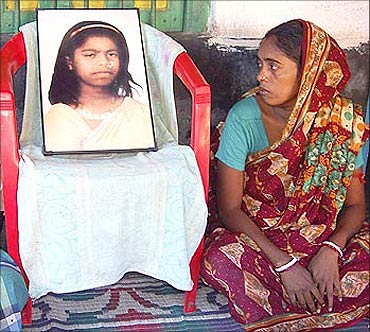 Tapasi Malik's mother looks at her daughter's photograph. Tapasi lost her life during the protest against the Tata Nano factory in Singur.