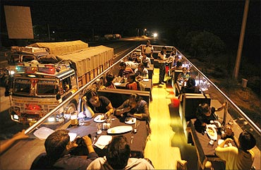 People dine on a double-decker bus which has been converted to a mobile restaurant.