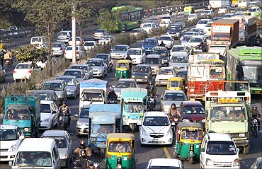 Traffic moves along a busy road in New Delhi.