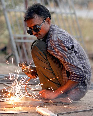 A welder works at a workshop.
