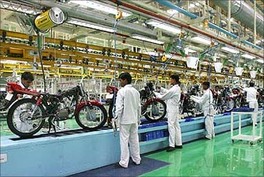 Employees work in an assembly line at Hero Honda's newly inaugurated plant in Haridwar.