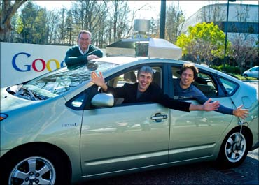 (L to R) Eric Schmidt, Larry Page and Sergey Brin in a self-driving car.