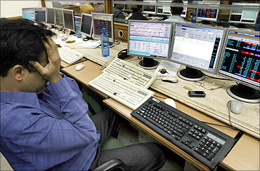 A broker reacts while trading a