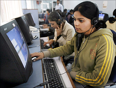 Employees at a call centre provide service support to customers at Siliguri, West Bengal.