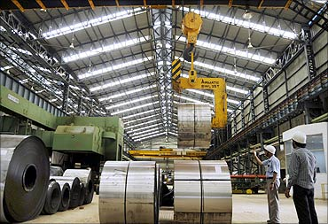 Employees work inside a steel factory in Agartala.