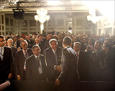 U.S. President Barack Obama greets members of the audience after delivering remarks at the U.S.-India business council and entrepreneurship summit in Mumbai, India, November 6, 2010. Obama announced $10 billion in business deals on Saturday as he arrived in India to boost U.S. exports and jobs after a mauling in mid-term polls.