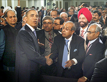 U.S. President Barack Obama meets members of the audience after delivering remarks at the U.S.-India business council and entrepreneurship summit in Mumbai, India, November 6, 2010. Obama announced $10 billion in business deals on Saturday as he arrived in India to boost U.S. exports and jobs after a mauling in mid-term polls.