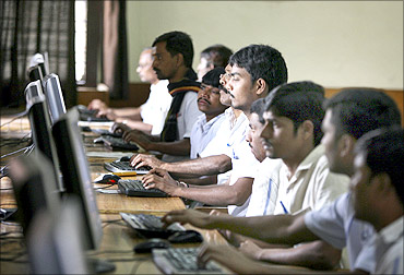 Inmates attend a training session for a business process outsourcing (BPO) centre located at the Cherlapally Central Jail on the outskirts of the southern Indian city of Hyderabad December 14, 2010. The jail authorities have so far selected 50 inmates on the basis of their educational qualifications and typing speed for the BPO unit, superintendent of Cherlapally Central Jail Gaddam Jayavardhan said. The telephone and internet facilities will not be provide inside the outsourcing centre and the prisoners will be dealing with data entry and other functions of BPO with the help of a private organization, Jayavardhan added.