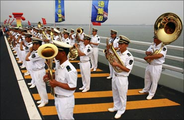 A band plays during the opening ceremony of the Qingdao Jiaozhou Bay Bridge in Qingdao.