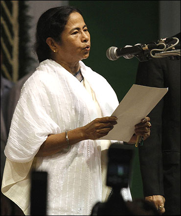 Trinamool Congress chief Mamata Banerjee takes an oath as chief minister of Bengal.