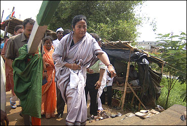File photo of Mamata Banerjee in front of the main entrance of the Tata car plant in Singur.