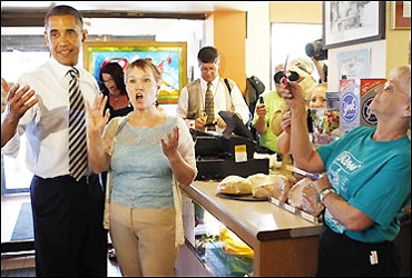 US President Barack Obama has his picture taken as he stops at Ross' Restaurant in Bettendorf.