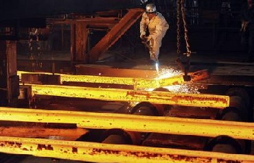 A labourer works at a steel factory workshop in Hefei, Anhui province in China