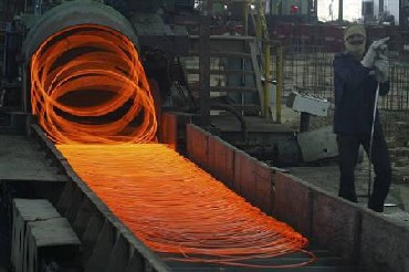 A labourer works inside a steel factory in Kanpur