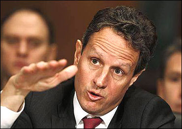 Secretary of Treasury Timothy Geithner gestures at the Senate Finance Committee.