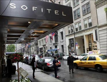People pass by the Sofitel hotel after Strauss-Kahn was arrested and charged with sexual assault.